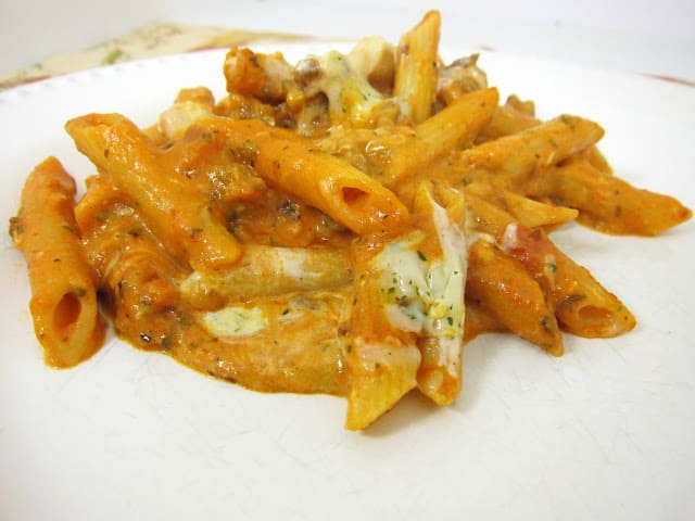 Baked Penne - quick and easy weeknight meal. Penne pasta, Italian sausage, onion, bell pepper, spaghetti sauce, cream cheese, mozzarella cheese. SO good! Everyone cleaned their plate!!
