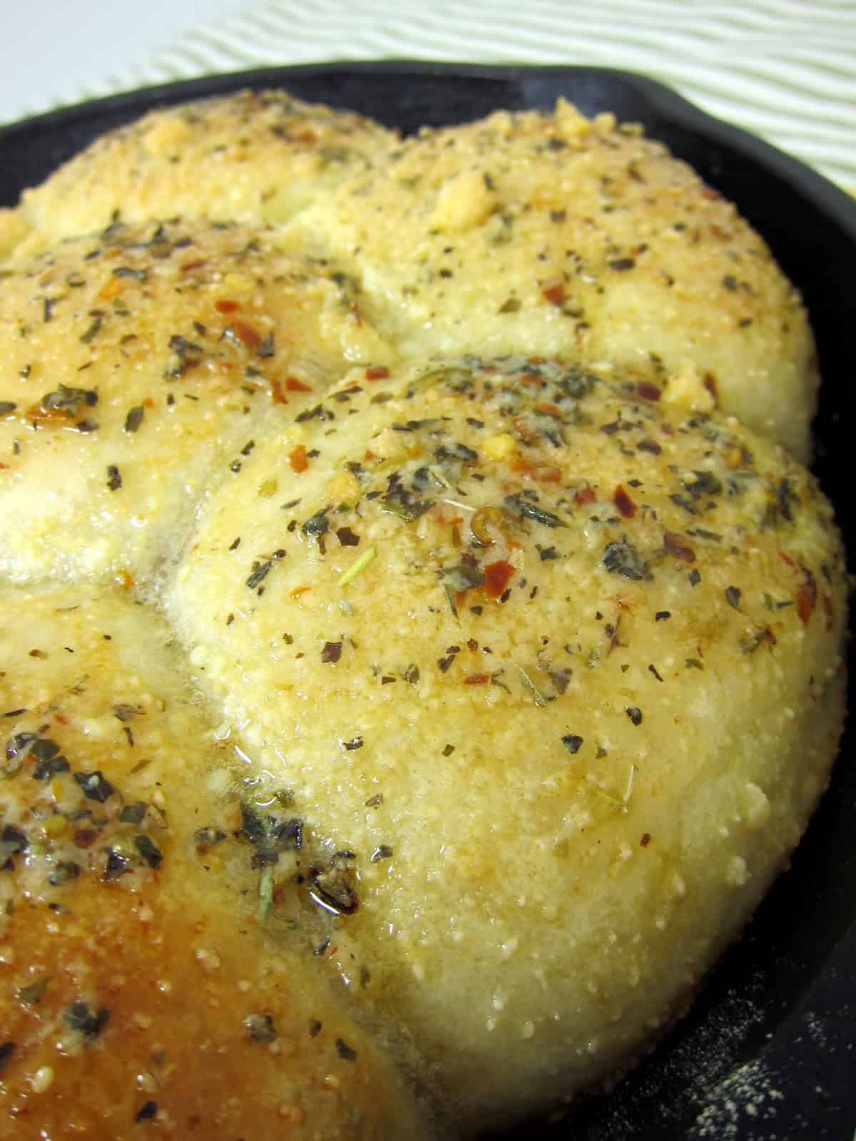 Italian Herb Skillet Bread Recipe - frozen bread dough, butter and Italian herb blend - SO good. I could literally eat the entire pan myself!