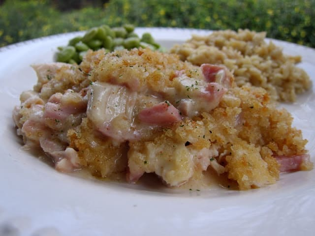 Chicken Cordon Bleu Casserole - crazy good!!! Super simple to make and everyone LOVED this casserole! NO cream of anything soup!! Chicken, ham, swiss tossed in a homemade cream sauce made with butter, flour, milk, lemon juice, dijon mustard, salt, pepper and paprika. Top casserole with panko bread crumbs, butter, seasoning salt and parsley. The whole family LOVED this easy dinner recipe. Can make ahead and refrigerate or freeze for later. #casserole #chickencasserole #weeknightdinner #freezermeal