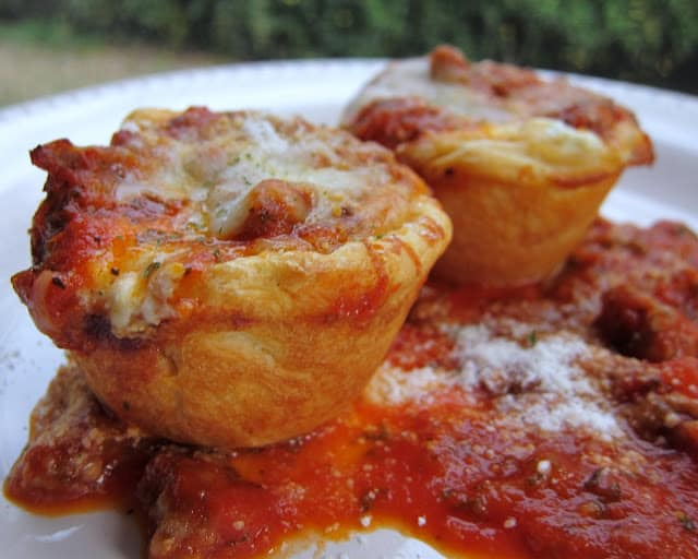 Lasagna Biscuit Cups Recipe - all the flavors of lasagna baked in a yummy biscuit cup! Cottage cheese or ricotta, mozzarella,   sausage or hamburger, spaghetti sauce baked in a biscuit muffin cup. Seriously amazing!  All the flavors of lasagna without all the work!