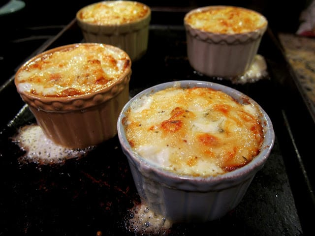 Individual Potato Gratin - thinly sliced potatoes, heavy cream, thyme and gruyere cheese - bake in individual ramekins. SO easy and SO delicious. Ready in under 30 minutes. One of our favorite potato side dishes!!! Everyone loves these potatoes.