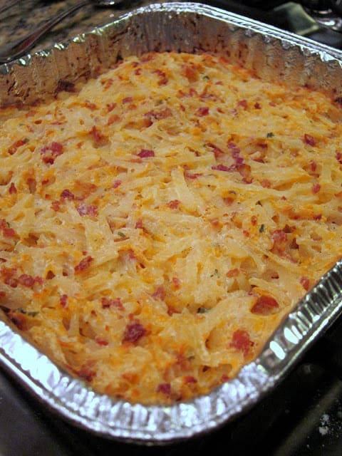 Crack Potatoes - the ORIGINAL recipe!! Potato casserole made with sour cream, cheddar cheese, real bacon bits, ranch dip mix, frozen shredded hash brown potatoes. Can make ahead and freeze for later. Everyone RAVES about these yummy potatoes! SO good!! Make them tonight!