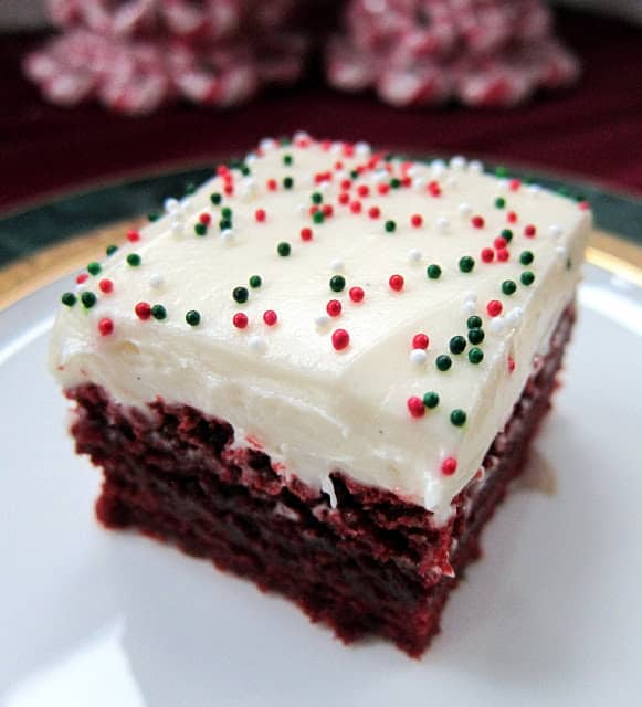 Red Velvet Brownies - quick homemade red velvet brownies topped with a homemade cream cheese frosting. These brownies are AMAZING! SO easy to make and even easier to eat! Make a great gift at the holidays too!