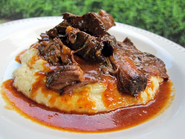 plate of pot roast over grits