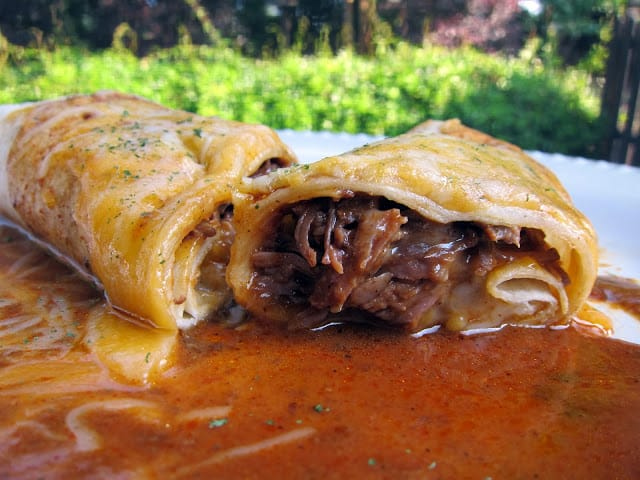 Slow Cooker Chile Colorado Burritos - stew meat slow cooked in a homemade enchilada sauce - wrap meat in tortillas and top with cheese to serve. OMG! AMAZING! We always double the recipe for leftovers.