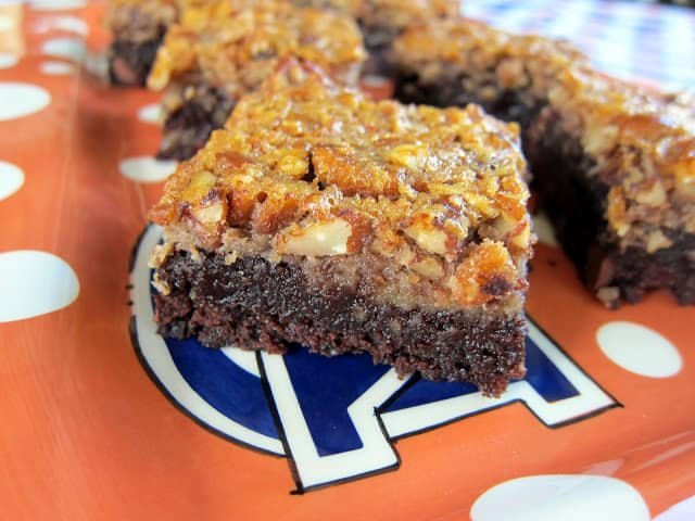 Pecan Pie Brownies - two of my favorite desserts combined into one. Brownies topped with pecan pie filling! SO good! All you need is a big scoop of vanilla ice cream and you are set! #brownies #dessert #pecanpie
