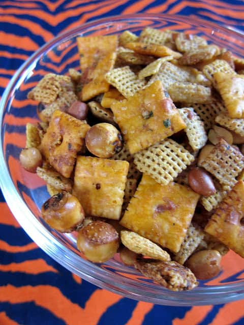 Cheesy Ranch Chex Mix - SO addictive! People go crazy over this at parties! Cheez-Its, Chex cereal, peanuts, pretzels, butter, worcestershire and Ranch. Can make ahead of time and store in an airtight container. Great for tailgating and the holidays. Always a hit!