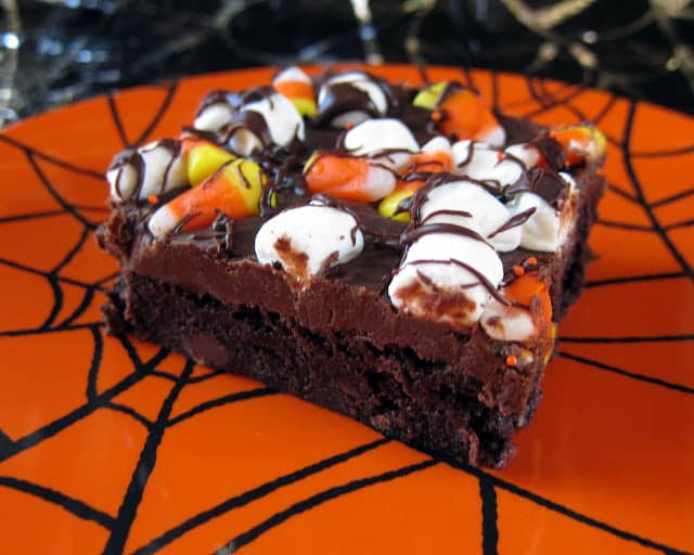 Haunted Road Brownies - brownies topped with a rich fudge frosting. Top with candy corn and marshmallows for a festive Halloween treat!