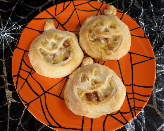Halloweenie Pockets - refrigerated biscuits cut out in a jack-o-lantern shape and filled with bbq hot dogs. Fun halloween treat!