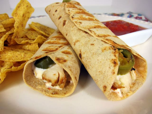 Chicken Popper Wrap - chicken, cream cheese and jalapeños wrapped in a tortilla and grilled. Use whole wheat tortillas and light cream cheese for a healthy sandwich. We love to eat these for a quick lunch or dinner! Only takes a few minutes to make!