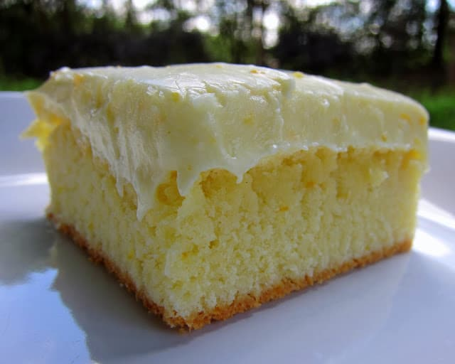 Orange Cake Recipe - homemade cake with orange juice and orange zest - topped with a homemade orange cream cheese frosting. My favorite cake!