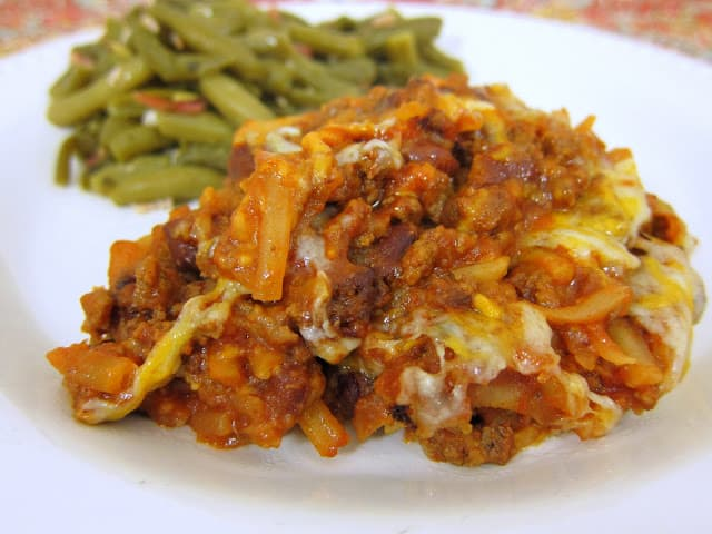 Cheesy Hash Brown Chili Bake - hamburger, sloppy joe sauce, canned chili, Rotel, frozen hash browns and cheddar cheese. Quick weeknight casserole. Can assemble and freeze for later. Kids (and adults) gobble this up!! Serve with green beans and cornbread for a full meal!