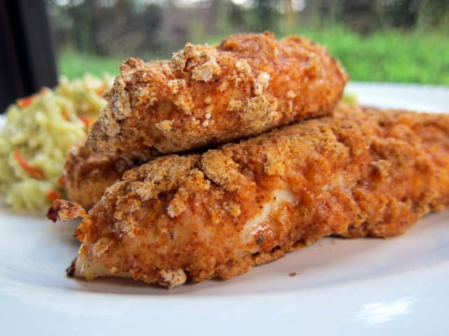 Spicy Chicken Tenders Recipe - chicken tenders coated in a homemade buffalo spice seasoning and baked. SO delicious. Can coat and freeze unbaked for a quick meal later.