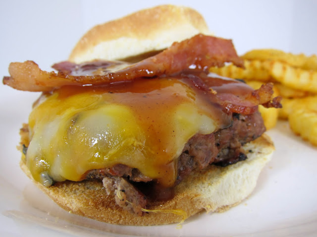 BBQ Burger Recipe - fire up the grill for these simple and flavorful burgers - hamburger seasoned with BBQ sauce and topped with cheese, bacon and BBQ sauce - SO good!!