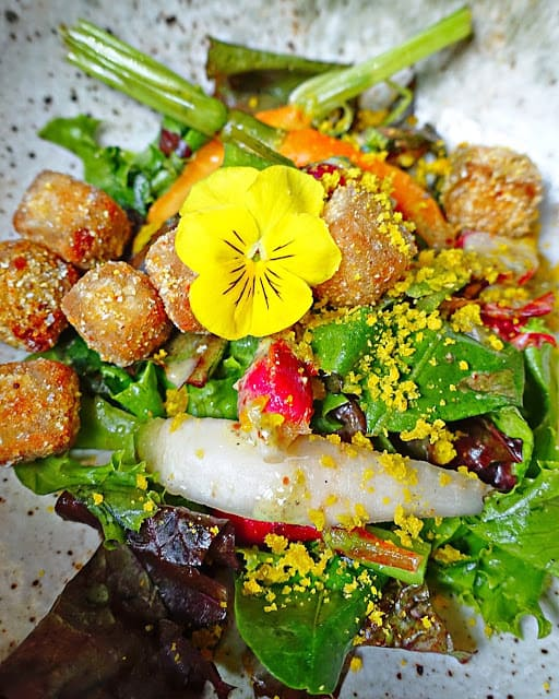 Salad of N09 Vegetables at Josephine in Nashville's 12 South neighborhood - salad topped with scrapple croutons, cured egg yolk and lavender.