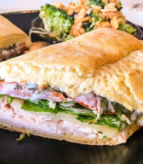 The Turkey and Spinach Aioli Sandwich at Ashely Mac's in Birmingham, AL gets two thumbs up! Fresh sliced turkey, tomatoes, baby spinach, Havarti cheese, and our homemade spinach aioli served on toasted ciabatta bread.
