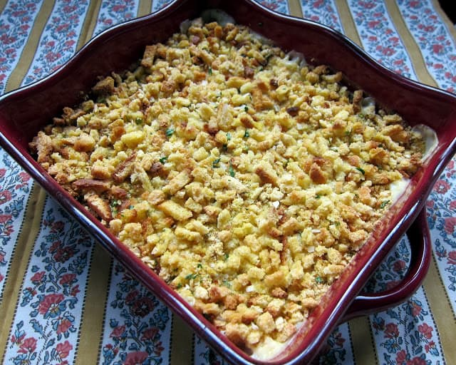 Yum Yum Chicken - creamy chicken casserole topped with cornbread stuffing. Cooked chicken, cream of chicken soup, cream of celery soup, sour cream, stuffing mix, chicken broth and butter. Can make ahead and freeze for later. Great quick weeknight casserole recipe! Kid Friendly!