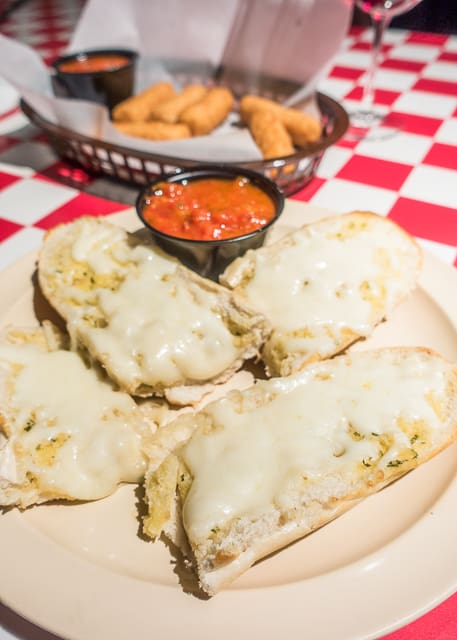 Cheesy Garlic Bread at Carmelo's -  Where to Eat in St. Augustine, Florida - we found several hidden gems in St. Augustine that you MUST try on your next trip. Pizza, Burgers, Sandwiches, Craft Cocktails, and CRAZY milkshakes! Something for everyone!!