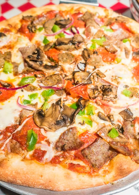 Carmelo's Supreme Pizza at Carmelo's -  Where to Eat in St. Augustine, Florida - we found several hidden gems in St. Augustine that you MUST try on your next trip. Pizza, Burgers, Sandwiches, Craft Cocktails, and CRAZY milkshakes! Something for everyone!!
