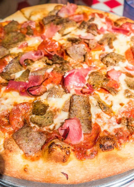 Meat Supreme Pizza at Carmelo's -  Where to Eat in St. Augustine, Florida - we found several hidden gems in St. Augustine that you MUST try on your next trip. Pizza, Burgers, Sandwiches, Craft Cocktails, and CRAZY milkshakes! Something for everyone!!