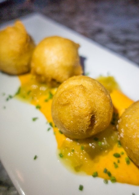 Crab Beignets at Ice Plant Bar - Where to Eat in St. Augustine, Florida - we found several hidden gems in St. Augustine that you MUST try on your next trip. Pizza, Burgers, Sandwiches, Craft Cocktails, and CRAZY milkshakes! Something for everyone!!