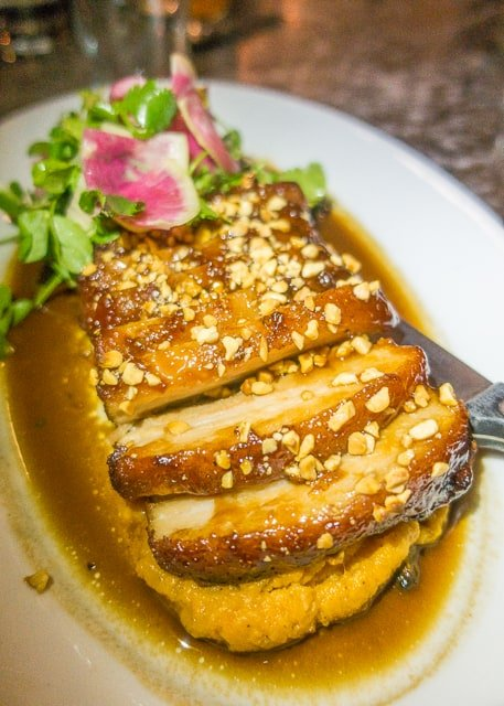Slow Cooked Duroc Pork Belly at Ice Plant Bar - Where to Eat in St. Augustine, Florida - we found several hidden gems in St. Augustine that you MUST try on your next trip. Pizza, Burgers, Sandwiches, Craft Cocktails, and CRAZY milkshakes! Something for everyone!!