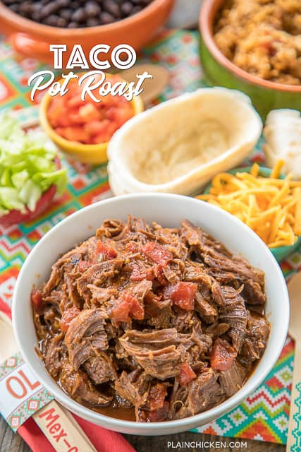 Slow Cooker Taco Pot Roast - shredded beef tacos. Only 5 ingredients - pot roast, au jus mix, taco seasoning, tomato juice and diced tomatoes and green chiles. Can serve shredded pot roast over rice with beans for a burrito bowl or in tortilla for shredded beef tacos. This is CRAZY good!!! Makes a great freezer meal too! #slowcooker #mexican #tacos