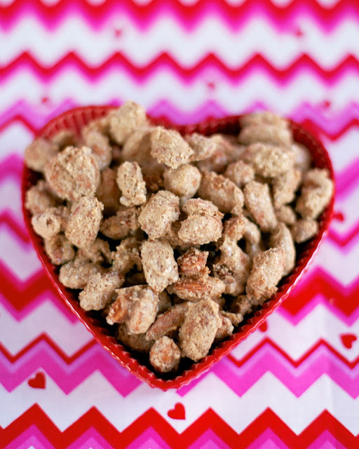 Cinnamon Sugared Almonds - SO much better than the mall!! Almonds tossed in egg white, water, vanilla, sugar, cinnamon and salt and baked. These are SO easy to make and they taste AMAZING!!! Whip up a batch ASAP! #almonds #copycatrecipe