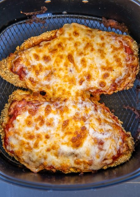 Air Fryer Chicken Parmesan - all the flavor and none of the fat! I am OBSESSED with this crunchy and delicious chicken! SO easy to make and ready in about 10 minutes. Chicken cutlets, eggs, flour, Italian breadcrumbs, panko breadcrumbs, parmesan cheese, spaghetti sauce and mozzarella cheese. Serves with a simple side salad and dinner is done!