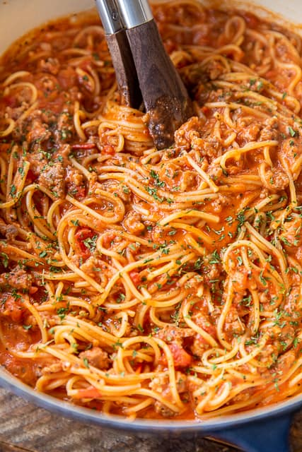 spaghetti and sauce in a cooking pot