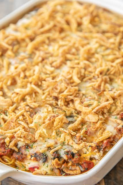 Baked Pasta with Sausage & Spinach - seriously delicious!! Can make ahead and freeze for later. Italian sausage, spaghetti sauce, diced tomatoes, cottage cheese, sour cream, spinach, spaghetti, parsley, garlic, monterey jack cheese, mozzarella cheese, french fried onions. Seriously THE BEST! Everyone cleaned their plate and went back for seconds! That never happens in our house. This is a keeper!! #casserole #spaghetti #freezermeal