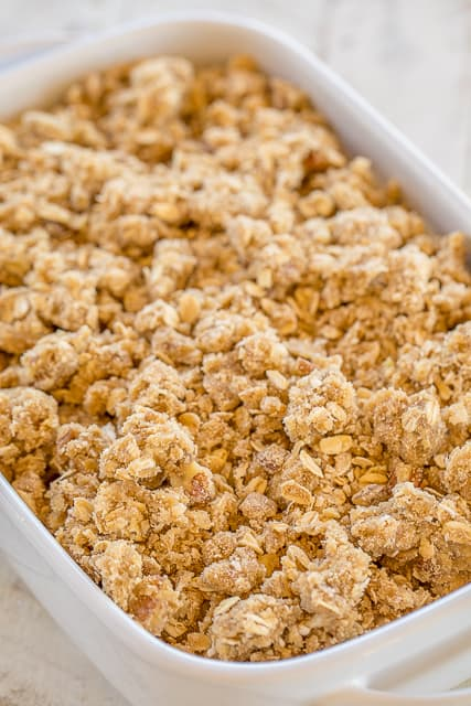 Banana Bread Cobbler - this is amazing!! SOOO much better than regular banana bread. The streusel topping makes this yummy dessert!! Self-rising flour, sugar, milk, butter, bananas, brown sugar, oatmeal and pecans. Top with vanilla ice cream and caramel sauce! This is lick-the-plate delicious!!! #bananabread #cobbler #dessert #dessertrecipe