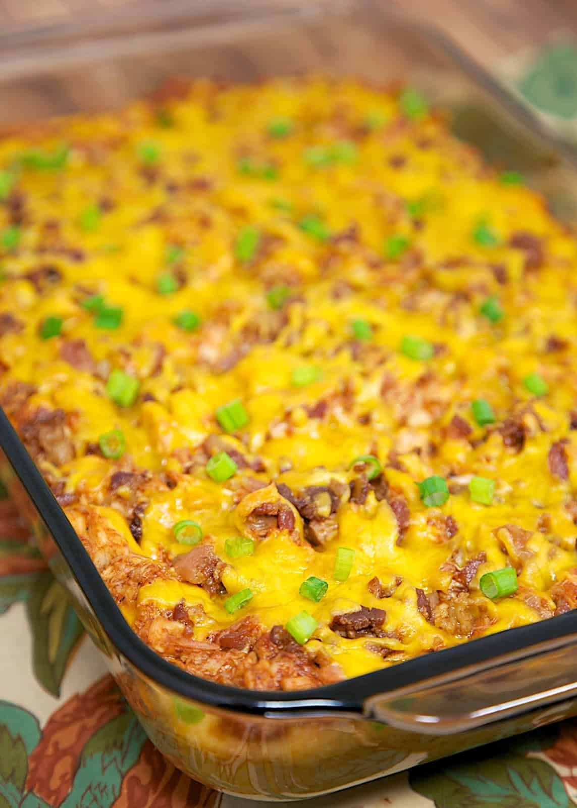 BBQ Chicken & Grits Casserole - cheesy grits topped with bbq chicken, bacon and cheddar. SO delicious!! Can make ahead of time and refrigerate until ready to bake.