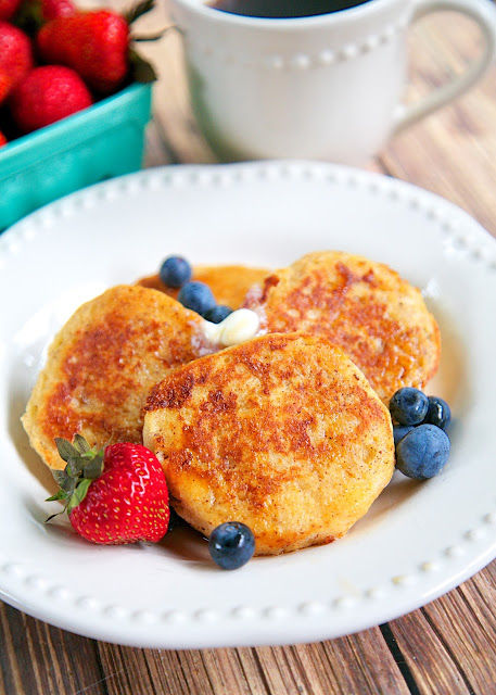 Biscuit French Toast Recipe - day old biscuits soaked in eggs, milk, and cinnamon, then grilled. Serve with syrup and fresh berries for a delicious breakfast! Great way to use up leftover biscuits!!