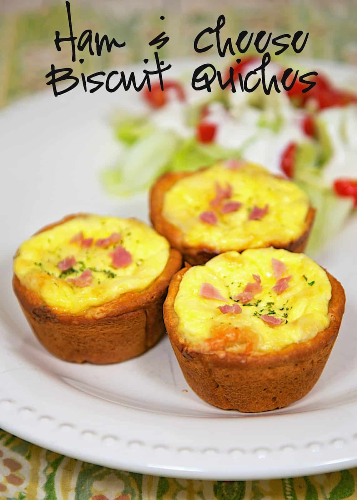 Ham & Cheese Biscuit Quiches Recipe - ham and cheese quiche baked in a biscuit crust. Great way to use up leftover holiday ham! Freeze leftovers for a quick meal later!!