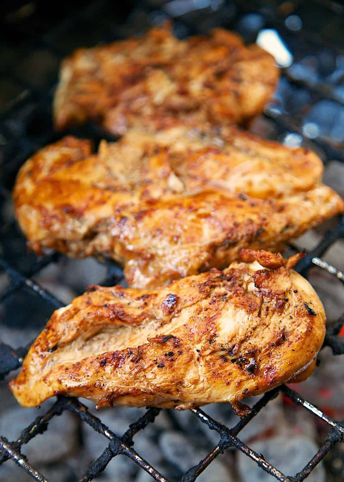 Bluegrass BBQ Chicken Recipe - chicken marinated in a tangy vinegar based bbq sauce - Seriously one of the best grilled chicken recipes we've ever made! Make extra chicken for leftovers - you're going to want it!