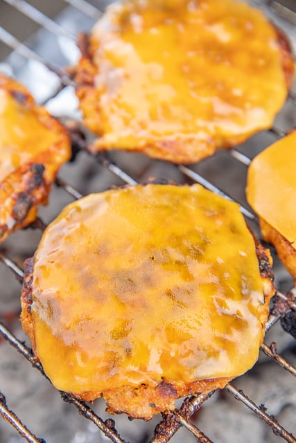 ground chicken burgers cooking on the grill