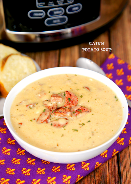 Slow Cooker Cajun Potato Soup - easy potato soup jazzed up with cajun seasoning and andouille sausage. Frozen hash browns, chicken broth, andouille sausage, cajun seasoning,chicken soup and cream cheese. SO easy and SOOOO good. Everybody went nuts over this! Can use smoked turkey sausage instead of andouille. Serve with some crusty bread for an easy weeknight meal!