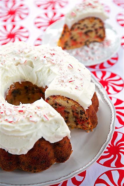 Candy Cane Chocolate Chip Pound Cake - homemade pound cake loaded with crushed candy canes and chocolate chips and topped with a quick homemade peppermint buttercream - AMAZING! Definitely going on our holiday table!