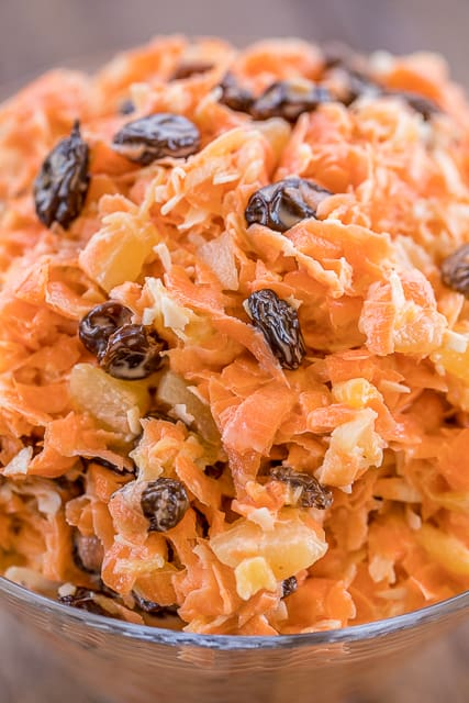 Carrot Salad - an easy and delicious side dish!! Only 6 ingredients - carrots, raisins, pineapple, coconut, sugar and mayonnaise. Reminds me of the carrot salad from Chick-fil-a!! SO good! Great side dish for potlucks or brunch. Can make in advance and refrigerate until ready to serve. YUM! #sidedish #carrotsalad #saladrecipe