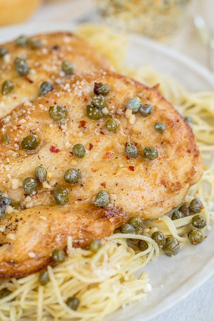 Champagne Chicken Piccata - no one will ever guess how easy this is! With a few simple ingredients you can make a restaurant quality meal! Chicken, garlic, butter, lemon, champagne and capers. Ready in about 10 minutes! This is the most requested chicken dish in our house! #chicken #easychickenrecipe #chickendinner