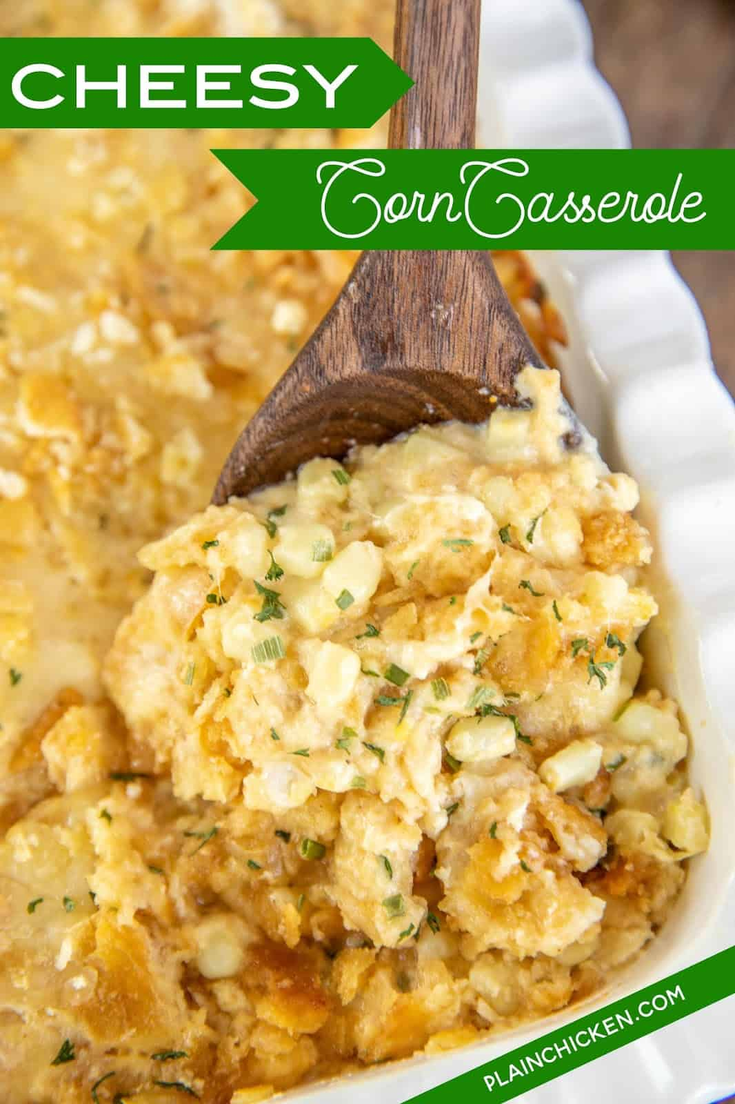 spooning corn casserole from baking dish