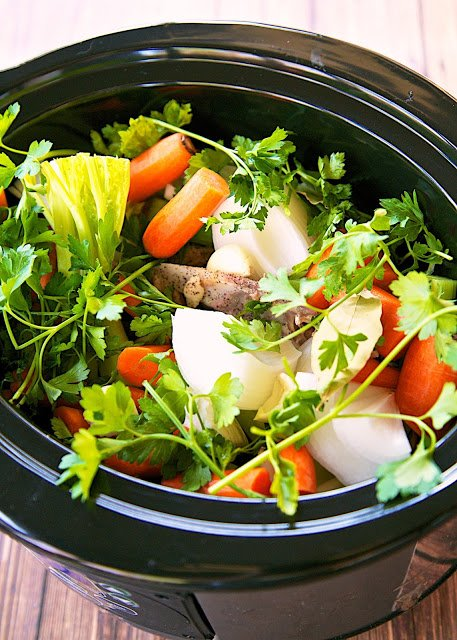 Slow Cooker Chicken Broth Recipe - don't throw away that rotisserie chicken after you eat it. Put it in the slow cooker with some veggies and water, 8 hours later you have the most flavorful chicken broth ever! You'll never use the boxed stuff again. Can freeze the broth to use later.