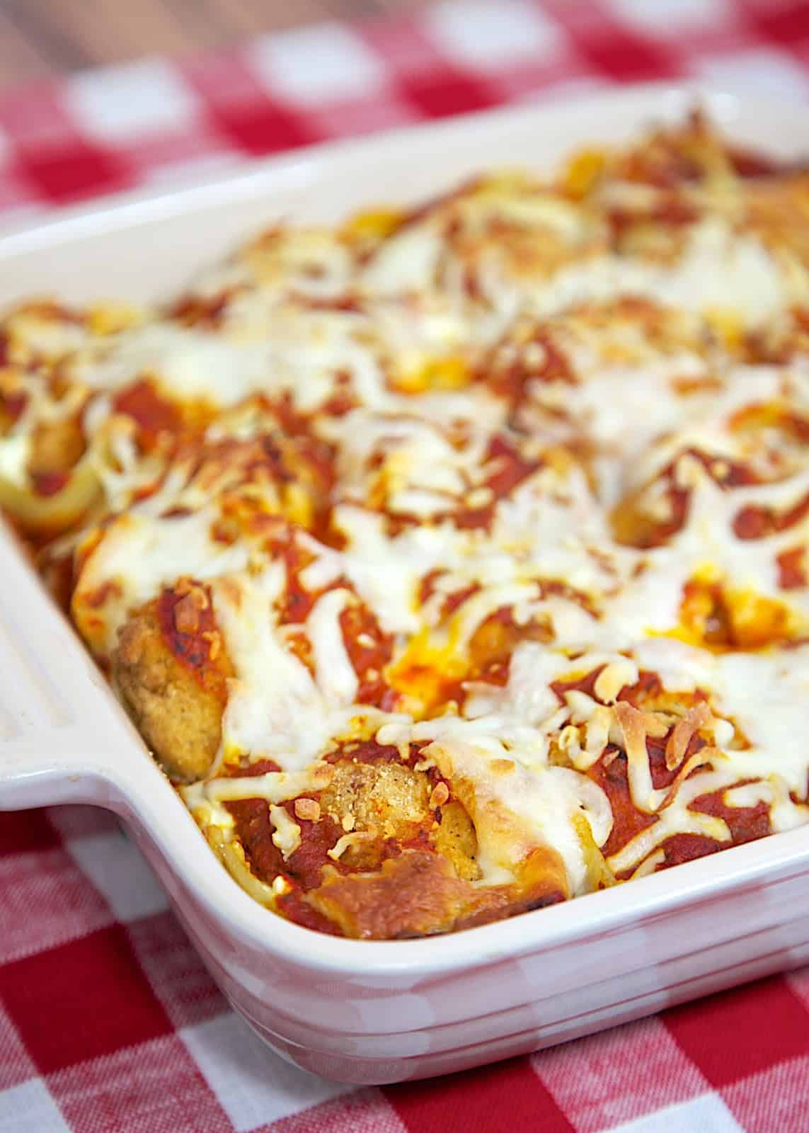Chicken Parmesan Stuffed Shells -  jumbo pasta shells stuffed with cheese, frozen popcorn chicken and spaghetti sauce - also makes a great freezer meal! Easy make ahead weeknight meal!