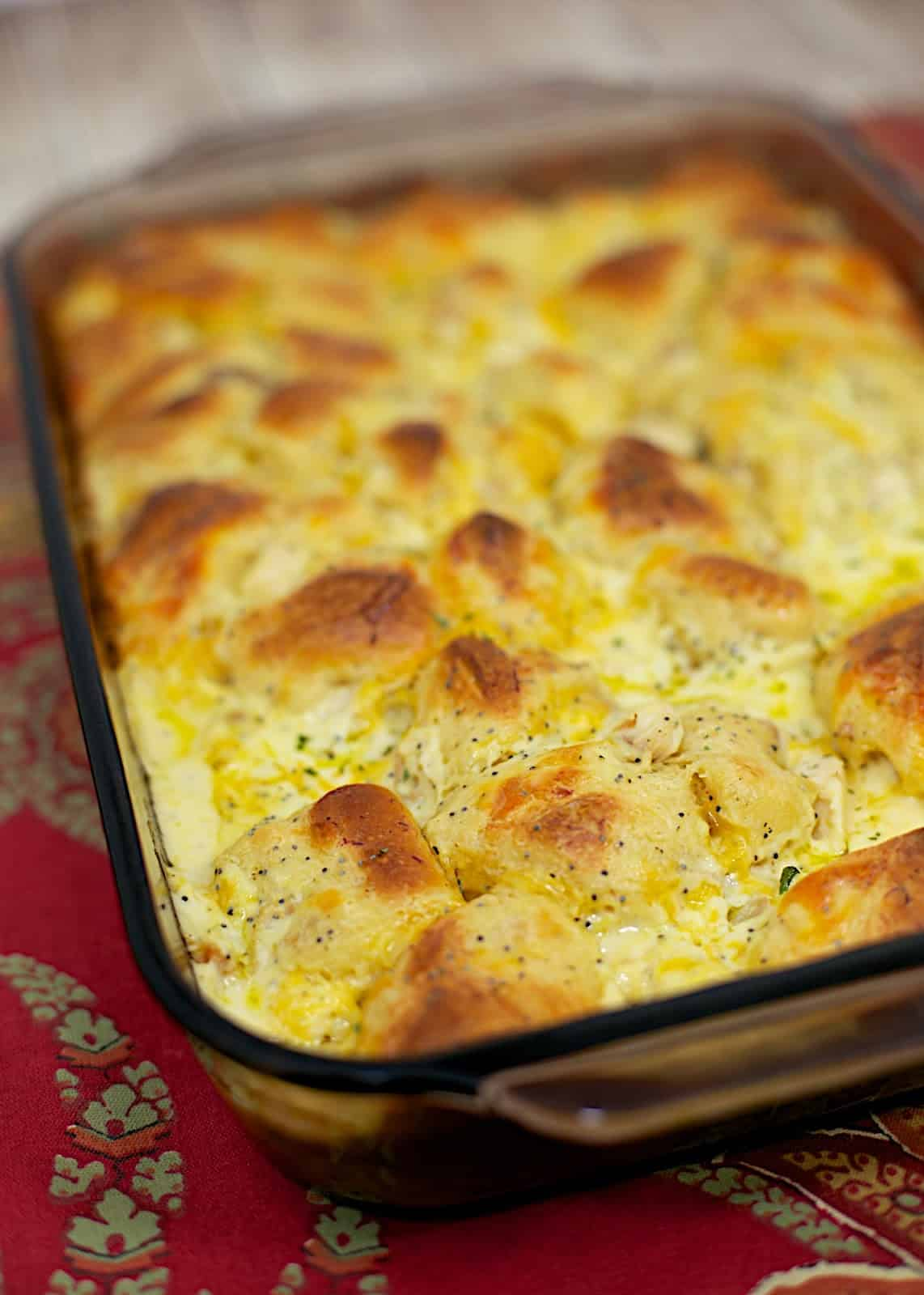 Poppy Seed Chicken Bubble Up - our favorite chicken casserole turned into a bubble up - the best of both worlds! Ready in 30 minutes! Everyone loves this easy chicken casserole recipe! Chicken, sour cream, cream of chicken soup, cheddar cheese, poppy seeds tossed with refrigerated biscuits. SO good!!! Such a family-friendly casserole recipe. Kids go crazy over this!