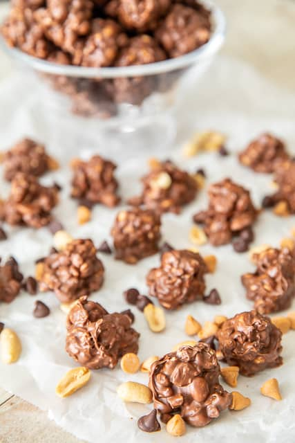Chocolate Butterscotch Peanut Clusters - only 4 ingredients in this yummy no-bake treat! Chocolate chips, butterscotch chips, toffee bits and peanuts. We could not stop eating this yummy candy!!! Great for parties or a homemade holiday gift. I like to put them in a Christmas tin and give them to neighbors and co-workers. YUM! #candy #peanuts #chocolate #nobake