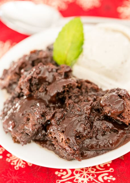 Chocolate Cobbler - seriously delicious! Only takes a minute to prepare and it tastes AMAZING! Perfect ending to your meal. Butter, sugar, flour, milk, cocoa powder, vanilla, chocolate chips and boiling water. Serve warm out of the oven with vanilla ice cream. SO GOOD!
