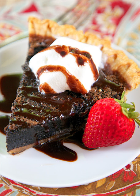 Minny's Chocolate Pie - classic southern chocolate pie. Light and fudgy brownie pie. Only a few simple ingredients - pie crust, sugar, cocoa powder, eggs, vanilla, butter and evaporated milk. Takes a minute to make! The hardest part is waiting on it to cool so you can eat it! Serve with whipped cream or ice cream on top! Great for a potluck!