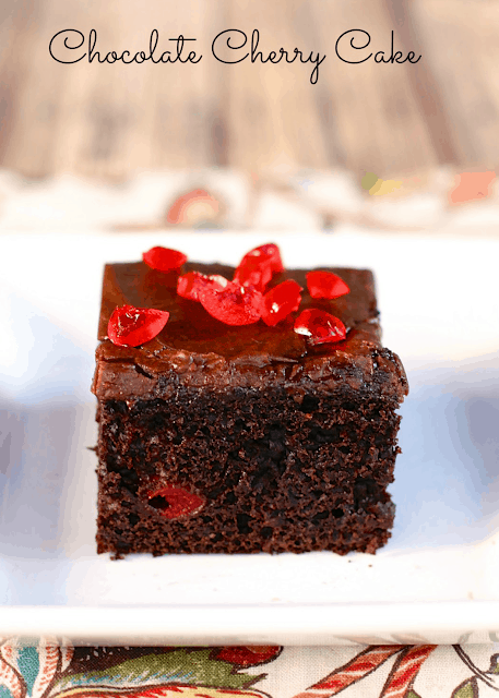 Chocolate Cherry Cake - doctored up cake mix with cherry pie filling and almond extract. Topped with a quick homemade chocolate frosting. This cake is requested for birthday's and potlucks! SO good!