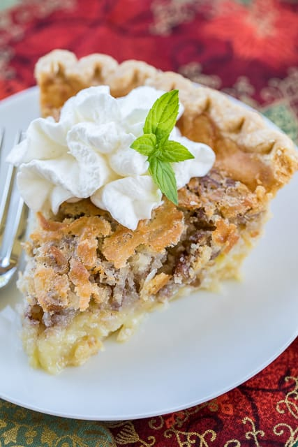 Coconut Pecan Chess Pie recipe - two favorites in one dessert! Quick and delicious homemade chess pie loaded with coconut and pecans! Pie crust, sugar, eggs, butter, buttermilk, cornmeal, coconut extract, coconut, pecans. Can make ahead of time and refrigerate until ready to serve. Top with fresh homemade whipped cream. SO good! A MUST for your holiday meal!! #pie #dessert #dessertrecipe